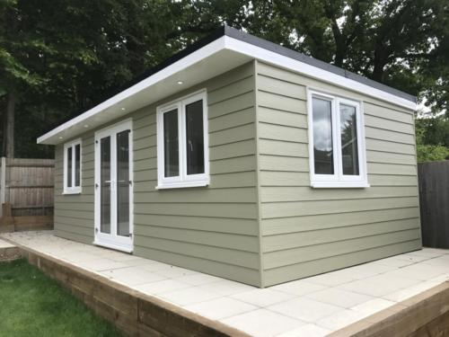 Marley eternit cedral lap cladded garden room with pvc window and doors